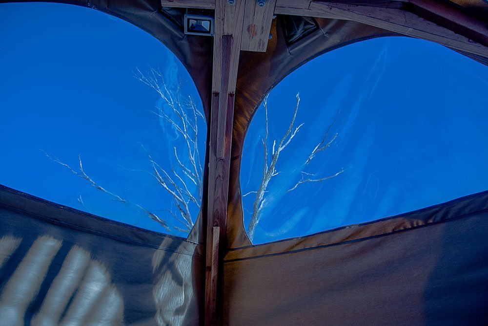 Blue skies outside a snow dome